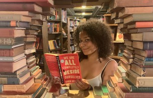 Photo of India Sposato holding a book in The Last Bookstore