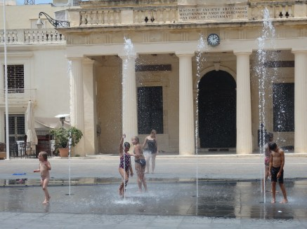 Kids playing in the Spring Water in Front of the Palace, Valletta, Malta