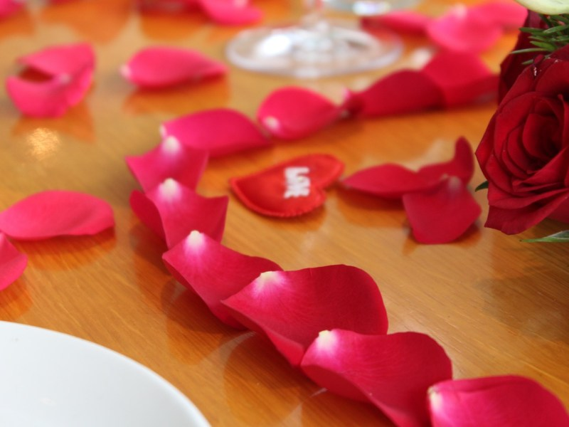 Rose Petals forming a heart design on a table