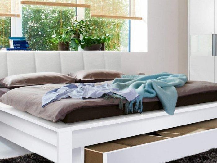 Чем удобна кровать с выдвижными ящиками