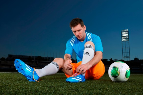 Lionel Messi laces up some bright blue boots- these super saturated Adidas Sambas were designed for the FIFA World Cup 2014 (image source: Adidas)