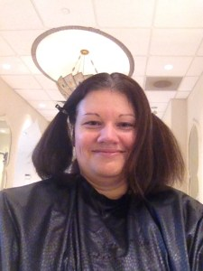 No I didn't go for the pigtail look. I'm waiting for Jenny to apply the color to get rid of the grays.
