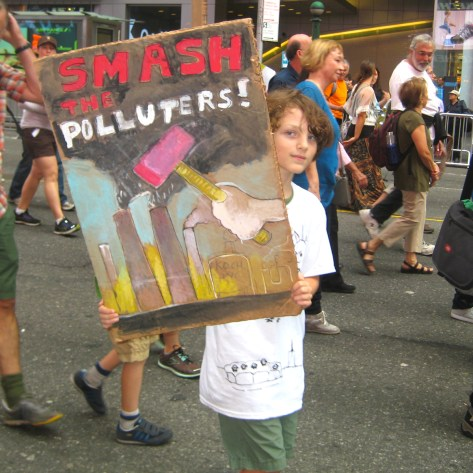 9/21/14 New York, NY - A young protester walks at the People's Climate March.