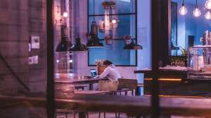 man in cafe at computer