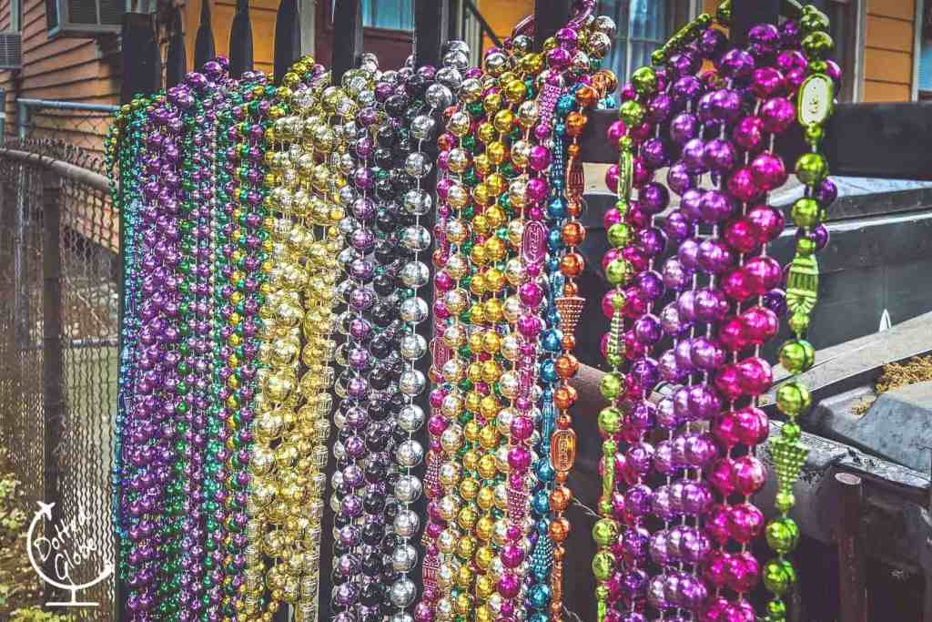Beads hung on a fence on Magazine St during Mardi Gras in New Orleans