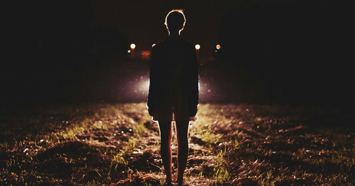 girl in front of headlights