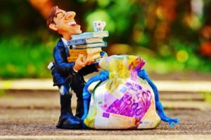 man holding tax books
