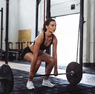 woman performing a deadlift. One of 5 full body exercises in this blog post.