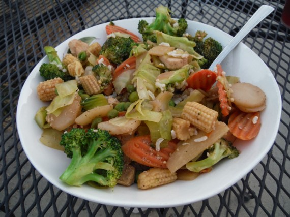 A healthy mixed vegetable stir fry over a tiny bit of brown rice.
