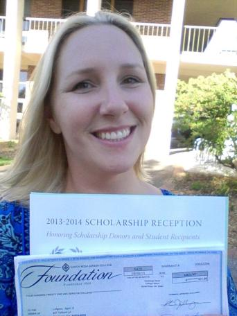 Accepting part of my $1000 Osher-Lahm Scholarship I received!