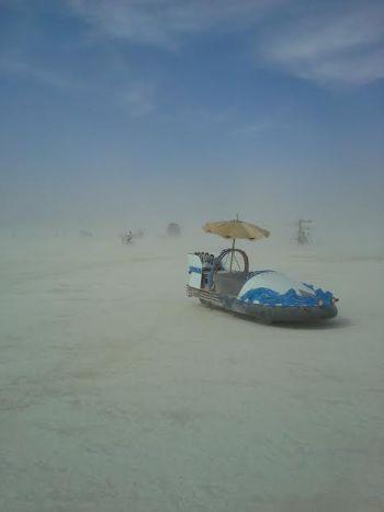 A sweet art car in the desert.