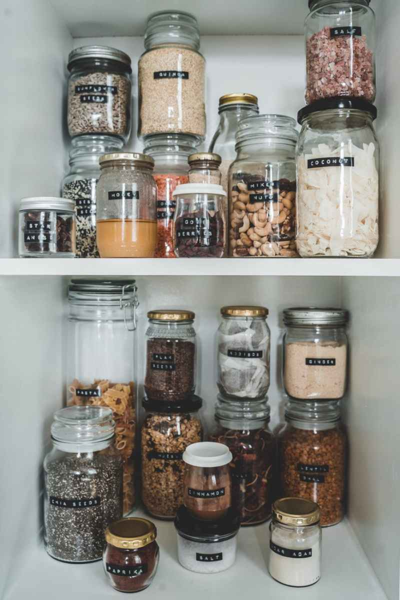 clear glass jars with brown and white beans meal prep