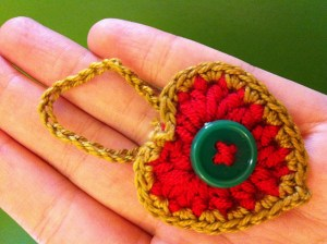 Crocheted heart ornament decorated with a button