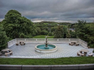 Fountain pation overlooking a pitch and putt gold course at Abbeyglen Hotel in Clifden, Ireland