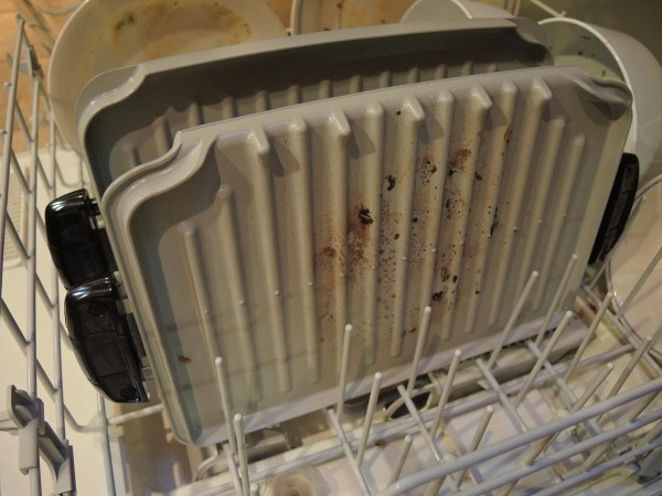 ooking surfaces come off the George Foreman Evolve grill and are dishwasher safe