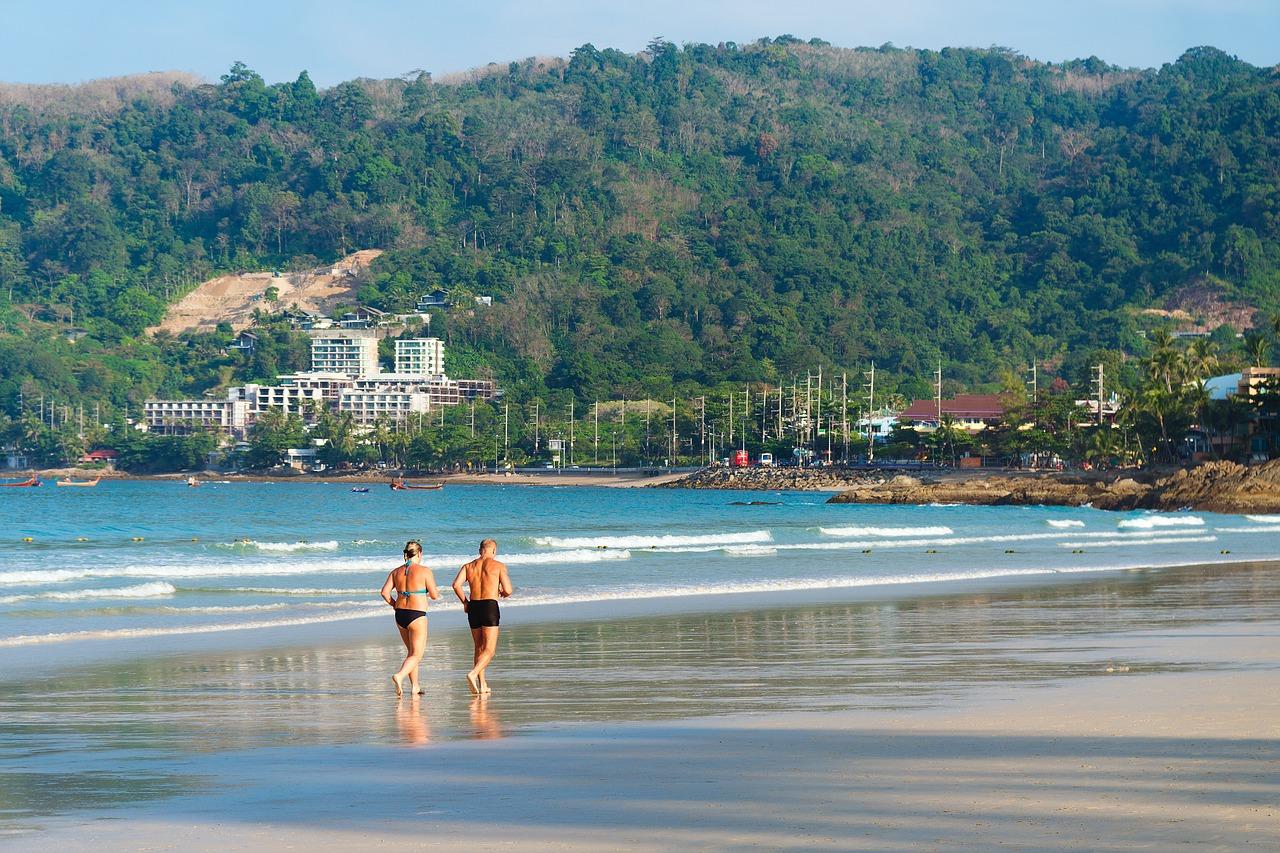 Seniors walking on the beach - seniors traveling