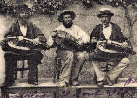 Three Hurdy-Gurdy Players