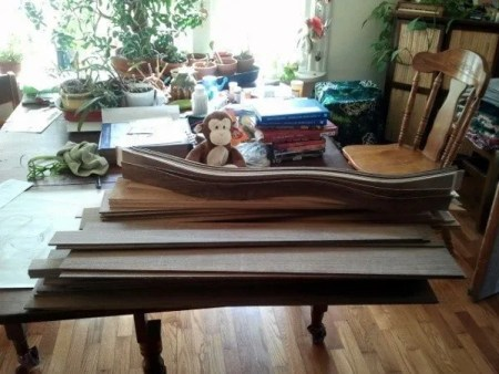 My apprentice sorts sides and backs for the next run of dulcimers.