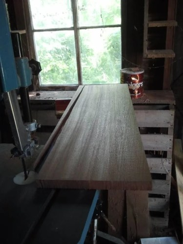Ripping dulcimer fretboard stock on the bandsaw to get a straight edge parallel to the direction of the grain