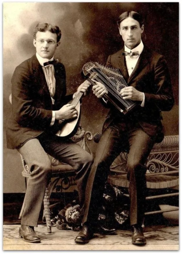 Vintage photograph of a mandolin and harp-zither duet