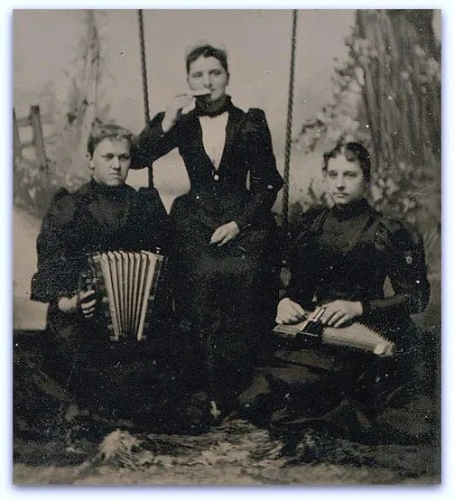 Harmonica, accordion and autoharp played by three lovely ladies.