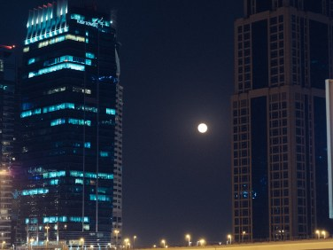 Moon and Skyscrapers. Olympus 45mm f1.8 Dubai Street photography