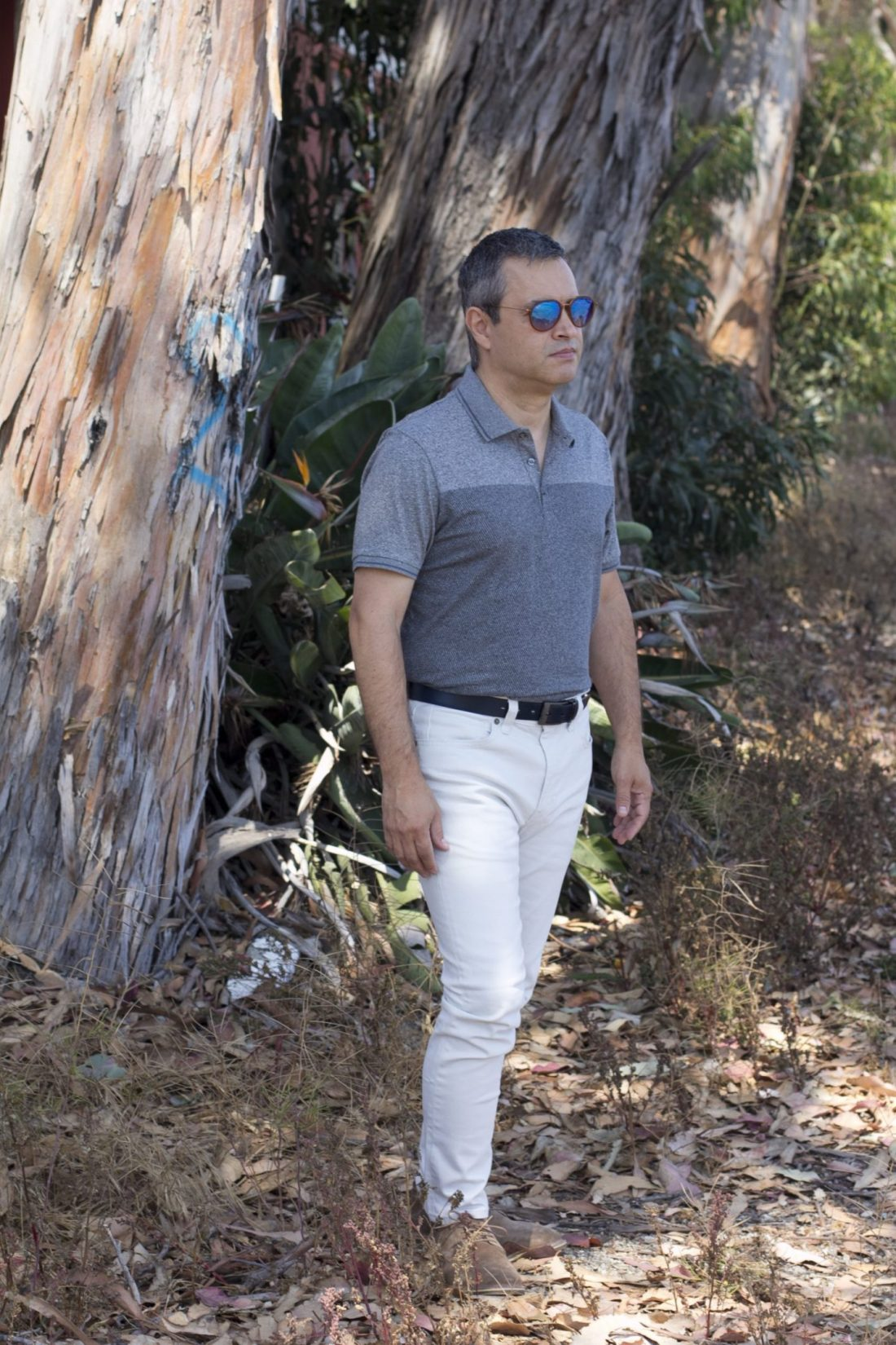 Marks & Spencer cotton blend textured polo shirt, blue leather buckle reversible belt, skinny fit stretch jeans, and suede desert lace-up shoes