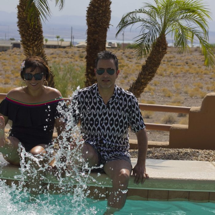 Travel blogger couple Rossana & Douglas poolside in Lake Havasu