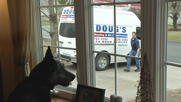 Dog sees Doug's Heating and Air Technician Arriving for Appointment