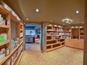 taking a dark basement hall and turning into a warm inviting library