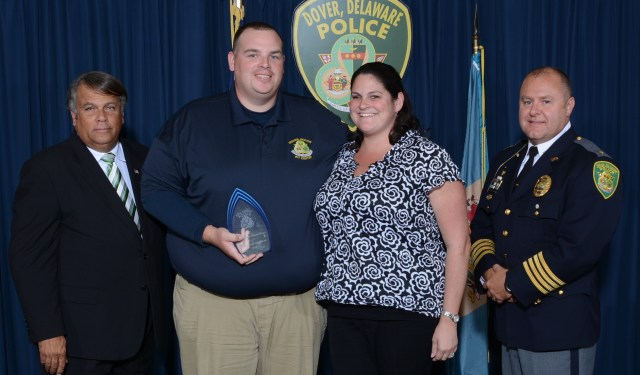 Dispatcher Mark Hall receives the Civilian of the Year Award, accompanied by his wife, Jaime.