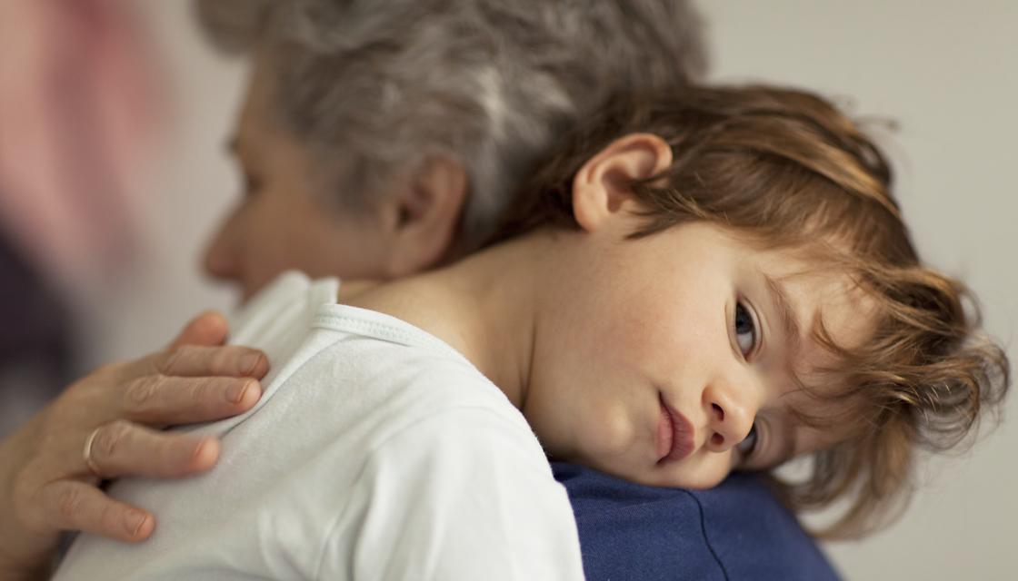 Small boy hugging his grandmother
