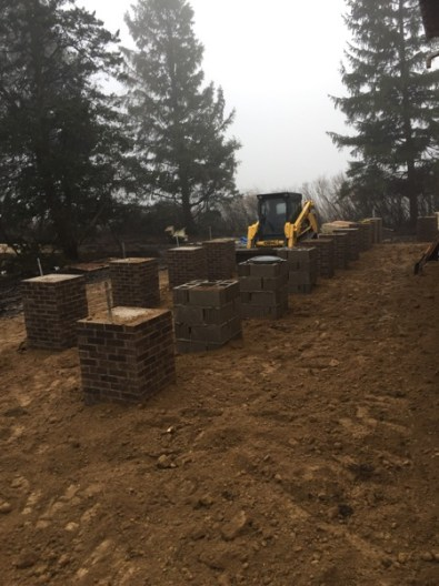 After the bricks were all laid, Tom & Brad went through and filled around them.