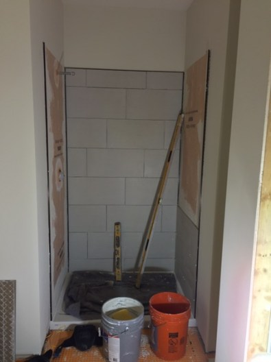 Downstairs shower - tile started