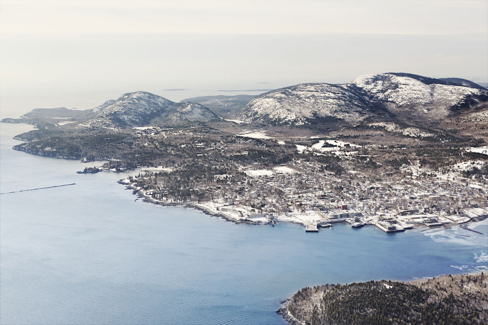 The edge of the earth: An aerial view of Mount Desert Island takes in the town of Bar Harbor, vast Frenchman Bay, and Acadia's wintry wilderness.