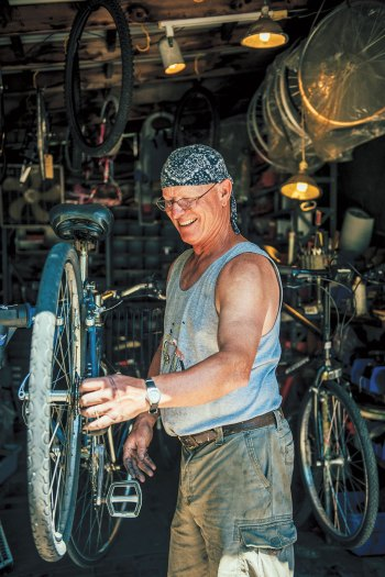 Brad Burkholder tunes a bike at Brad's Bike Rental on Peaks Island.