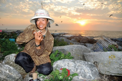 Jennifer Ma, a Project Puffin intern in 2011, holds a puffin fledgling.