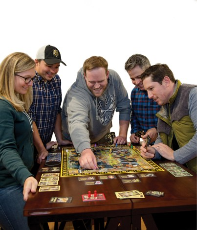 group of people playing board game