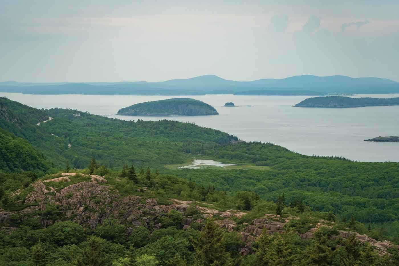 """Scenes from the Beehive Trail, where, as National Park Service materials explain, """"people challenge their bodies and minds . . . and are rewarded with stunning views over Sand Beach, Thunder Hole, and the Gulf of Maine stretching to the horizon."""""""