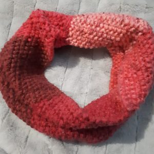 Seed stitch cowl done in a pink ombre acrylic yarn