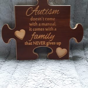 autism family puzzle shaped sign