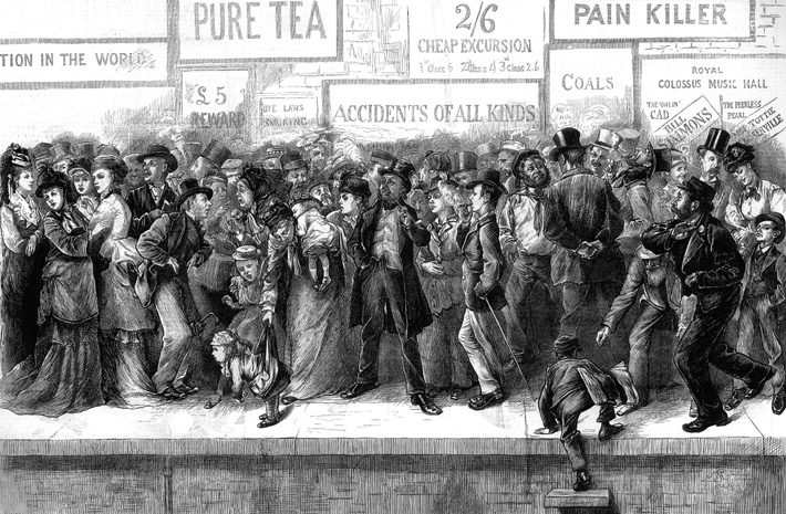 Passengers wait for a Bank Holiday excursion train, Victorian age [http://downloads.bbc.co.uk]