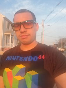 Juan walking outside wearing GUNNAR Optiks Work-Play Transitional Lens