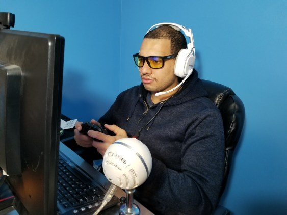 Juan gaming wearing GUNNAR Optiks Work-Play Transitional Lens