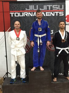 M H on the podium