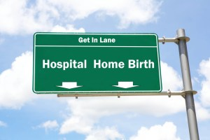 road signs saying to pick either hospital or home birth lanes