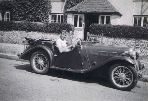 Bob Batholomew, circa 1949, in his red Singer Le Mans sports car. Photo via Bear Alley.