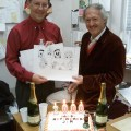 Former Beano editor Euan Kerr and Jim Petrie , the artist who drew the Beano character Minnie the Minx for 40 years before announcing his retirement on Monday 8th January 2001. Euan seen here presenting Mr Petrie with champagne and a retirement cake that day. Image courtesy DC Thomson