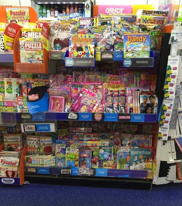 WH Smiths children's magazines rack, August 2015, which includes comics such as The Beano and both Panini's Doctor Who Adventures and Titan's Doctor Who Comic. As with some other Smiths stories (depending on their size) adventure comics aimed at older audiences such as 2000AD and Commando, and Panini's Marvel superhero titles, are racked in a separate section of this store.