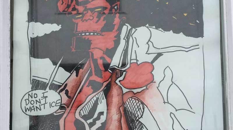 Hellboy art in the window of Wetherspoons, Kendal, in 2014.